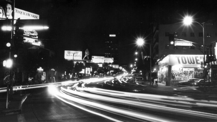 Dec. 13, 1988: The bright lights beckon night visitors to the famous Sunset Strip.