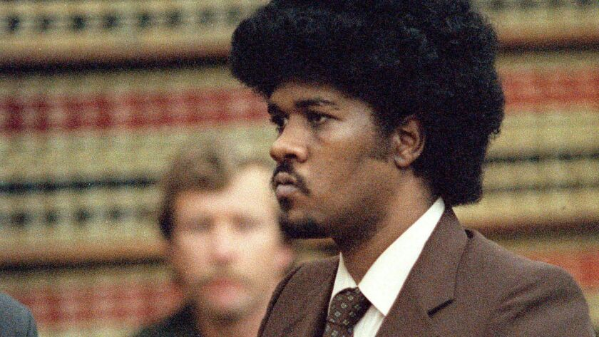 Convicted murderer Kevin Cooper stands before a San Diego judge in this May 1985 file photo when he was sentenced to death for the 1983 slayings of three Chino Hills family members and an unrelated child.