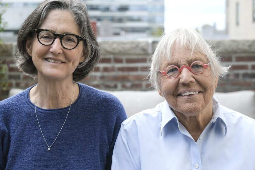 Two women in glasses looking at the camera