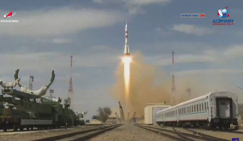 A rocket ship carrying a U.S.-Russian crew to the International Space Station blasts off from the Baikonur Cosmodrome in Kazakhstan.