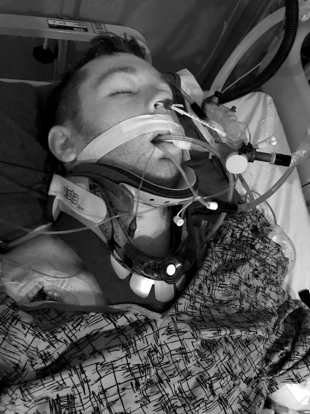 Jack Ryan Greener lies in the hospital after his accident.