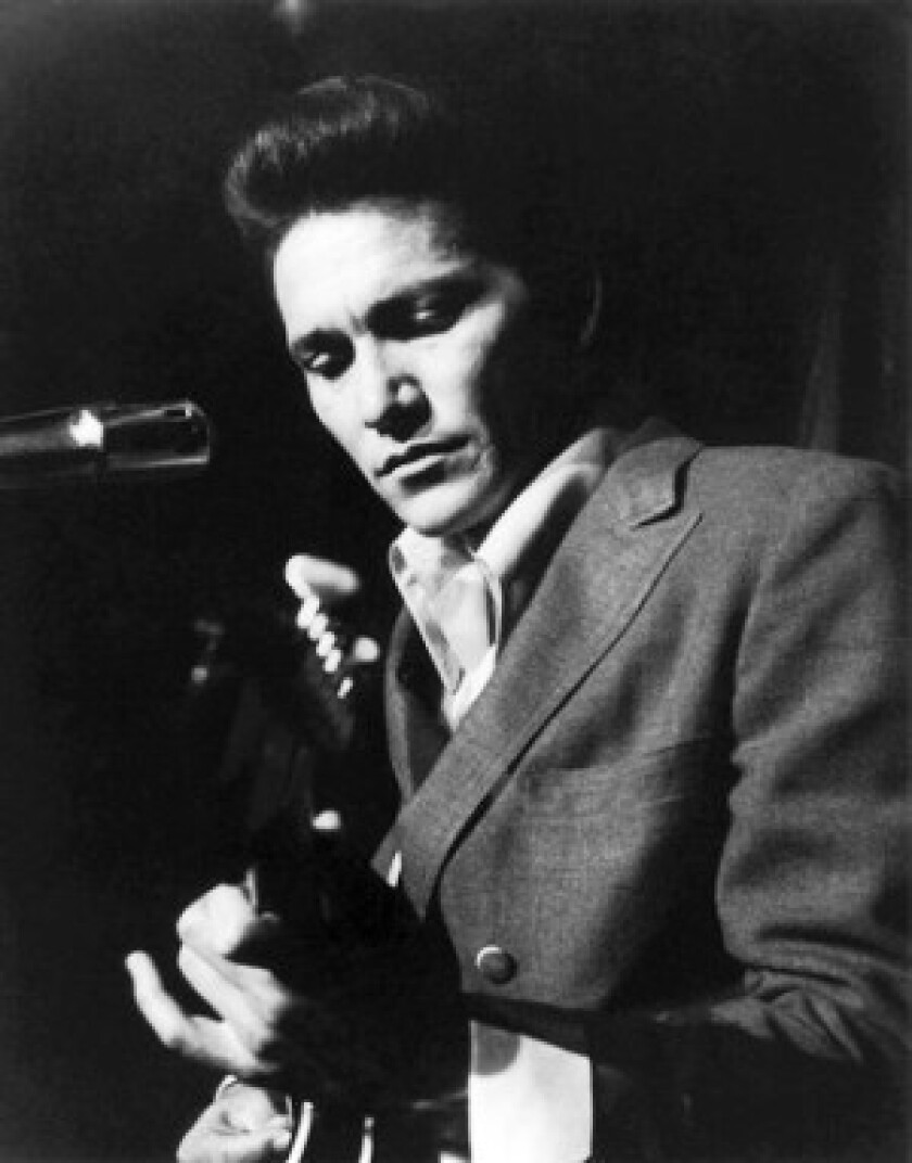 """Billy Lee Riley, performing in 1956, is best-known for his 1957 singles """"Flyin' Saucers Rock and Roll"""" and """"Red Hot."""" He also worked as a studio musician in Los Angeles."""
