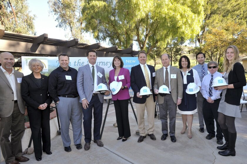 At the groundbreaking ceremony, Russ Murfey (fourth from left) and Scott Murfey (sixth from left) of Murfey Construction were recognized as integral parts of the team bringing new facilities to the Noah Homes campus in Spring Valley.