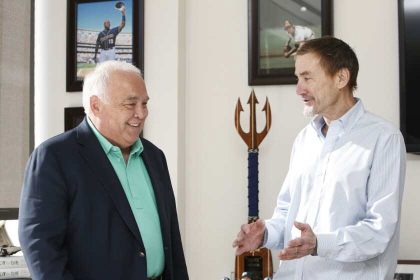 Padres owners Ron Fowler, left, and Peter Seidler at the team's offices in downtown San Diego.