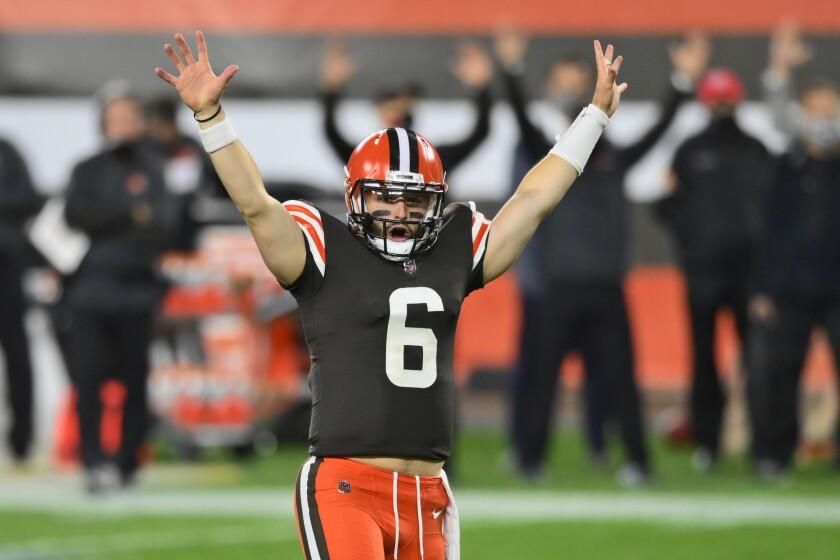 Cleveland Browns quarterback Baker Mayfield celebrates after running back Kareem Hunt scores a touchdown.