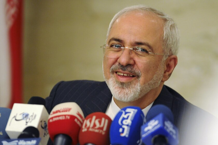 Iranian Foreign Minister Mohammad Javad Zarif speaks at a press conference in Kuwait City on Sunday, July 26, 2015. Iran's most senior diplomat arrived in Kuwait on Sunday to begin a three-nation regional tour aimed at deepening ties with Arab neighbors following the conclusion of the Islamic Republic's historic nuclear deal with world powers. (AP Photo)
