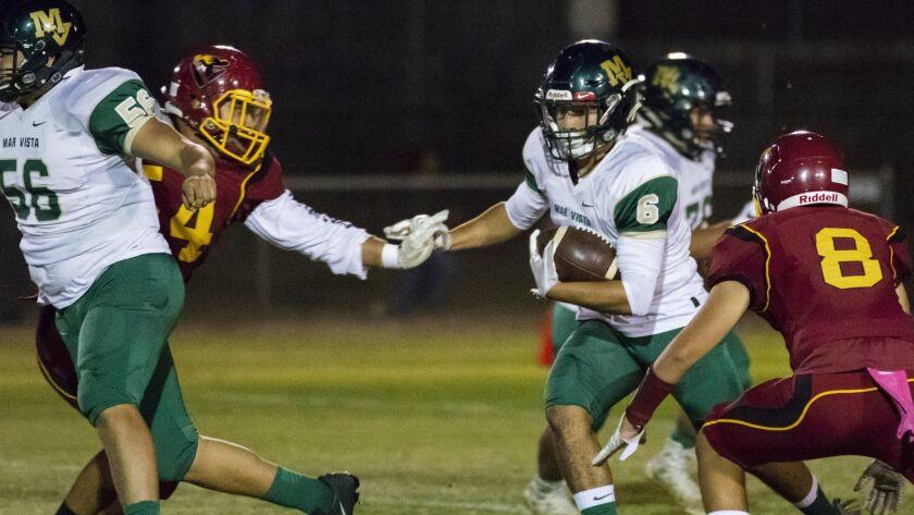 Mar Vista senior Jacob Galeana (6) breaks free for a 70-yard touchdown run Friday night.