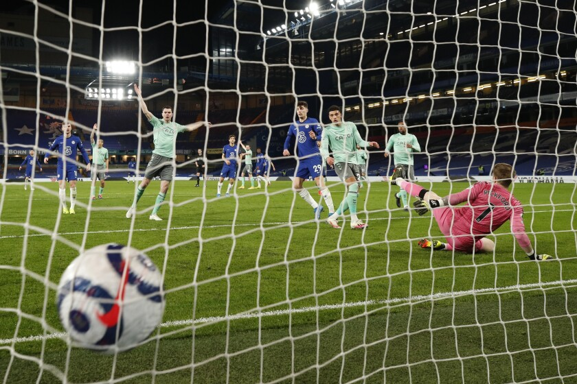 Everton's Ben Godfrey, center, scores an own goal during the English Premier League soccer match between Chelsea and Everton at the Stamford Bridge stadium in London, Monday, March 8, 2021. (John Sibley/Pool via AP)