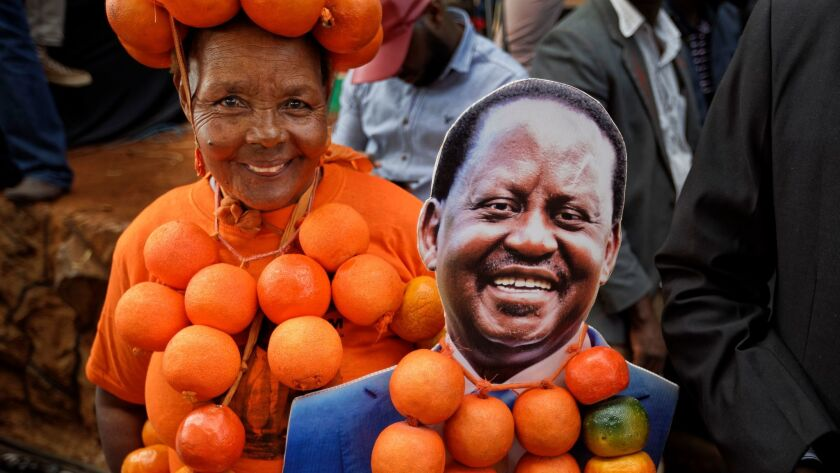 A supporter of opposition presidential candidate Raila Odinga flaunts oranges, the party's symbol, a