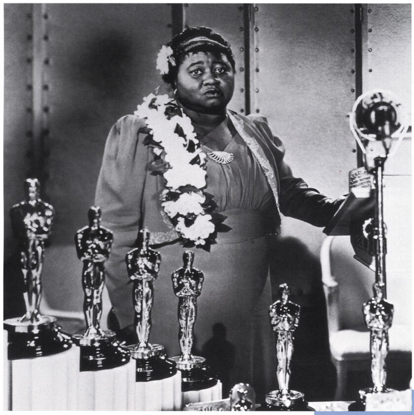 "Hattie McDaniel, who won the supporting actrees Oscar for her role as Mammy in ""Gone With the Wind,"" at the 1940 Academy Awards banquet. She was the first African American woman to be nominated. A Twitter project revolving around the book, and her image, has sparked a controversy over racism."