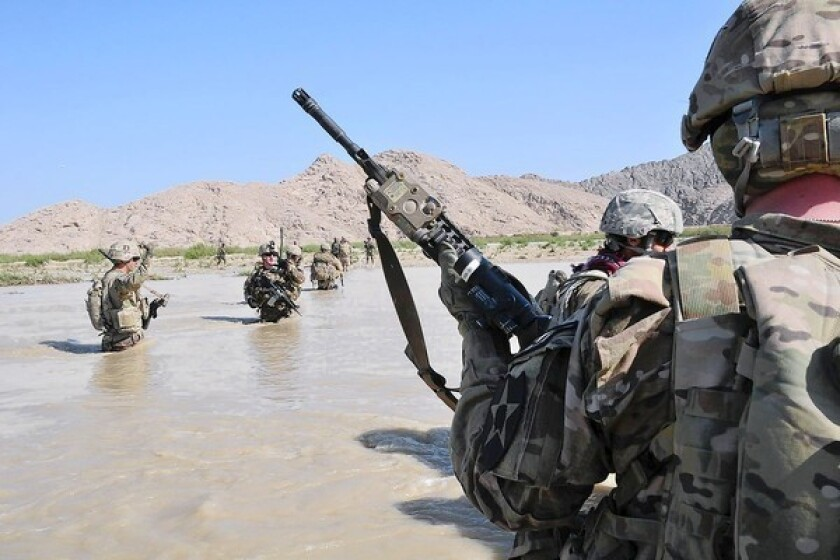 U.S. soldiers cross the Tarnak river on foot in Kandahar province, Afghanistan, in 2013.