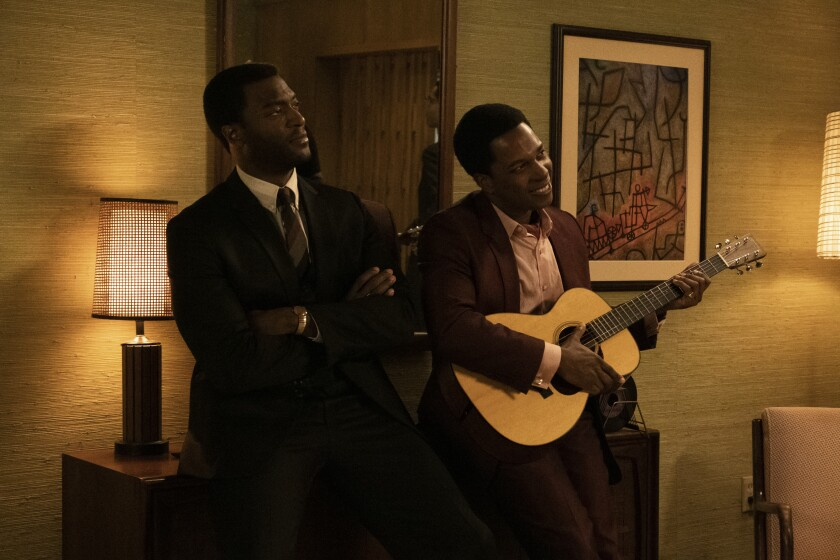 """Aldis Hodge and Leslie Odom Jr. in the 1964 hotel setting of """"One Night in Miami."""""""