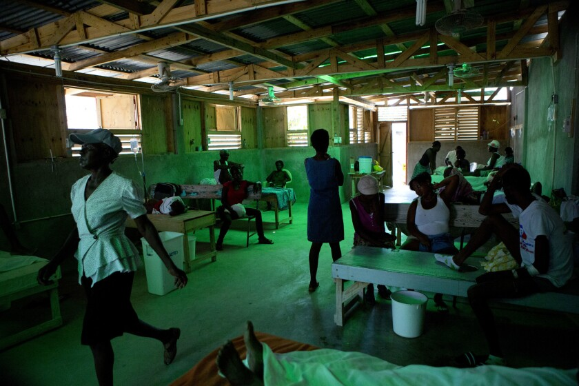Patients accompanied by family members rest inside a cholera ward in Les Cayes, Haiti