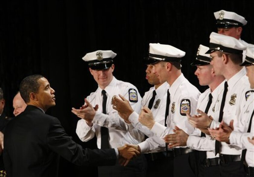 FILE - In this March 6, 2009 file photo, President Barack Obama greets officers at the Columbus Police Graduation Exercises in Columbus, Ohio. The nation's police departments are clamoring for an unprecedented amount of federal aid to forestall big local tax hikes or the possible layoff of nearly 40,000 police officers _ enough to staff the entire New York City Police Department. (AP Photo/Gerald Herbert, FILE)