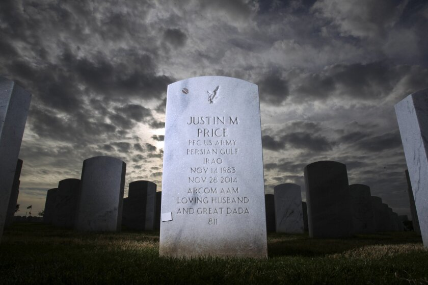 The headstone of Justin Price, an Iraq Army veteran who died by suicide, at Miramar National Cemetery in San Diego.