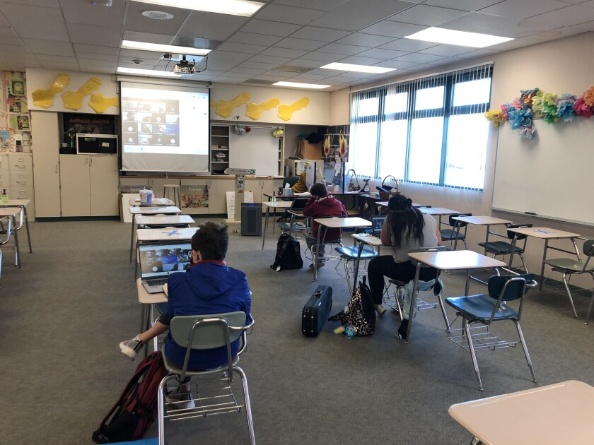 Students in a classroom at Carmel Valley Middle School on the first day return to school.