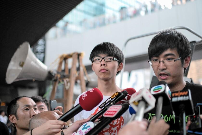 Hong Kong protest leaders Joshua Wong and Alex Chow