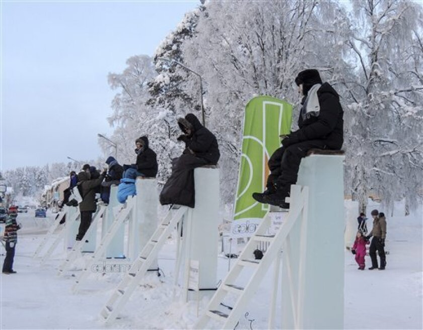 In this photo made available by the competition organizers, six contestants sit on ice blocks for the annual ice pole-sitting contest in Vilhelmina, Northern Sweden, Friday Feb. 8, 2013. Braving temperatures down to -18 F (-28 C), the contestants are only allowed to come down for ten-minute toilet break once every two hours, during their 48-hour ordeal. (AP Photo/Annika Andersson)