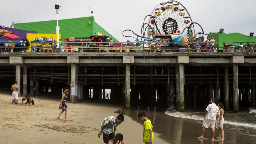 SANTA MONICA, CA. -- WEDNESDAY, JUNE 17, 2015: People play along the shoreline at Santa Monica Beac