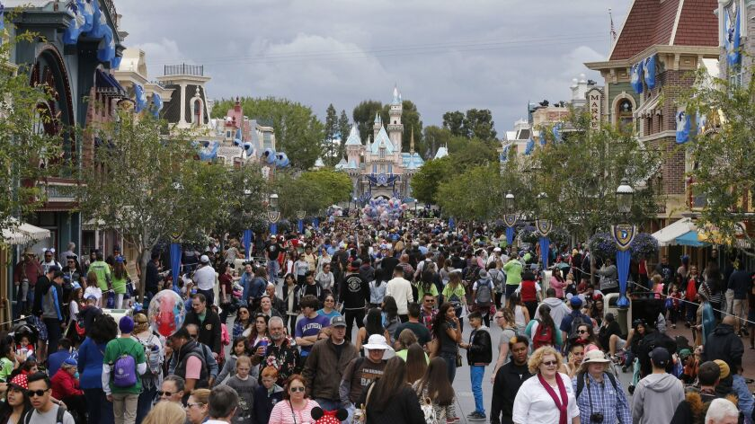 ANAHEIM, CA-MAY 22, 2015: Sleeping Beauty Castle and Main Street U.S.A. are adorned with diamond-st