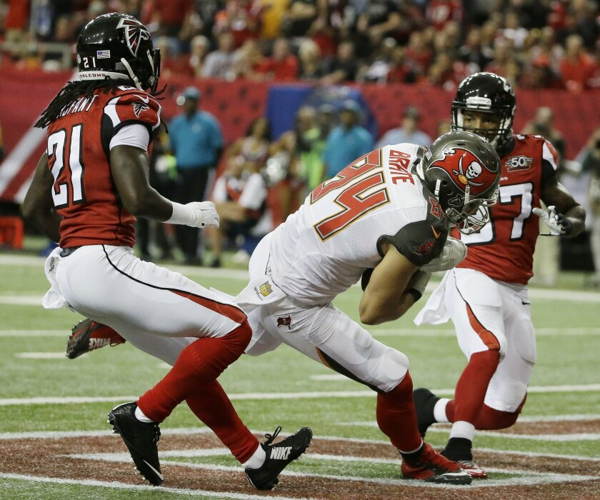 Tampa Bay Buccaneers Cameron Brate (84) moves into the end zone for a touchdown against the Atlanta Falcons during the first of an NFL football game, Sunday, Nov. 1, 2015, in Atlanta. (AP Photo/David Goldman)