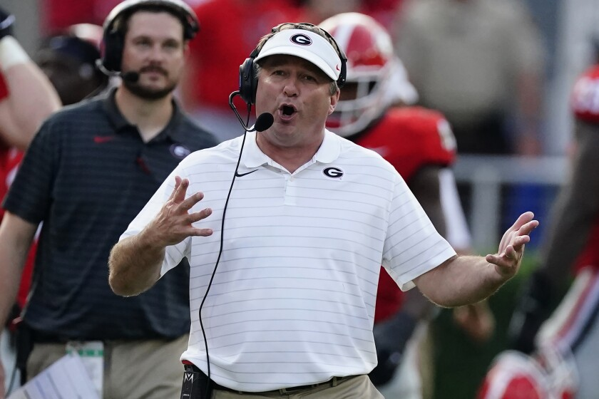 Georgia head coach Kirby Smart talks on his headset during an NCAA college football game against UAB, Saturday, Sept. 11, 2021, in Athens, Ga. (AP Photo/John Bazemore)