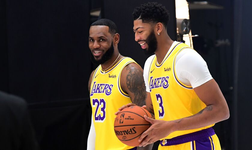 New Lakers teammates LeBron James (23) and Anthony Davis are all smiles during media day Friday at the team's training facility in El Segundo.