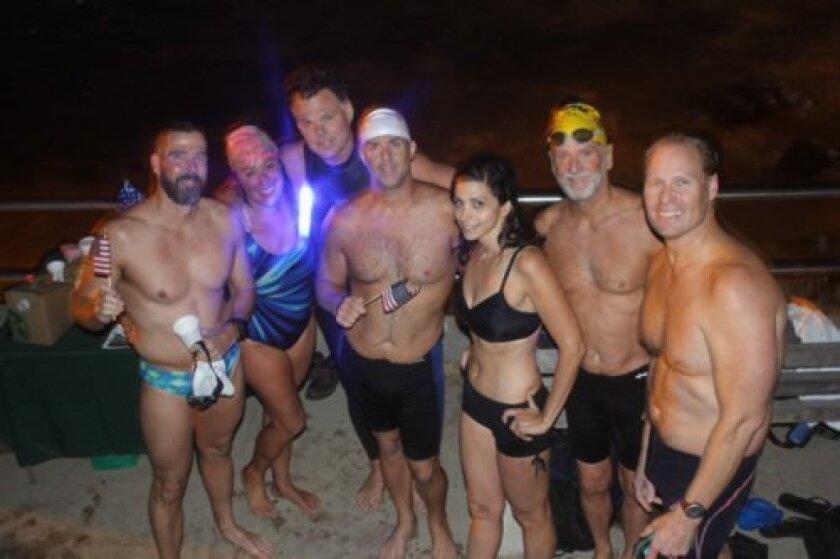 Tim Rayner, Penny Nagel, Lee Grove, Dan Simonelli, Artemis Spyridonidis, Dan Henry, Will Miller after their practice night swim at la Jolla Cove.