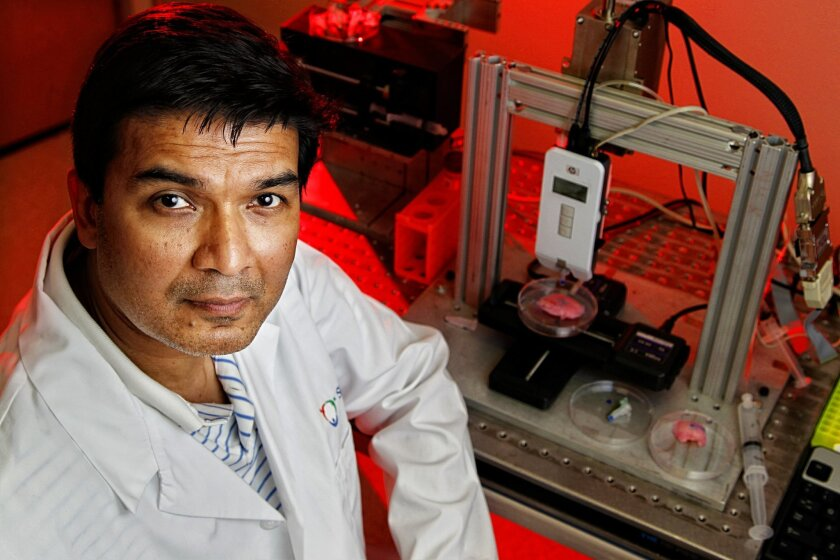 "Researcher Darryl D'Lima of Scripps Clinic with his ""bioprinter"" adapted from an HP inkjet printer that can produce cartilage."