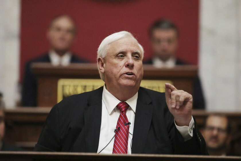 """FILE - In this Wednesday, Jan. 8, 2020, file photo, West Virginia Governor Jim Justice delivers his annual State of the State address in the House Chambers at the state capitol, in Charleston, W.Va. Gov. Justice confirmed on Tuesday, June 1, 2021, that he is personally liable for $700 million in loans taken by his coal companies from a lender in the United Kingdom that went bankrupt. The Republican governor took shots at the bankrupt Greensill Capital U.K. and said """"it is a burden on our family beyond belief."""" (AP Photo/Chris Jackson, File)"""