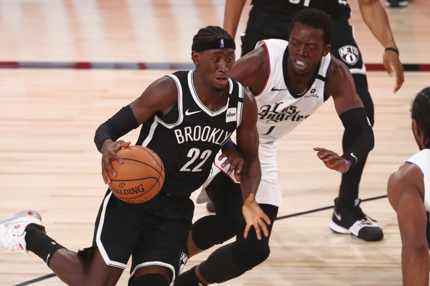 Brooklyn Nets guard Caris LeVert dribbles against the Clipppers.