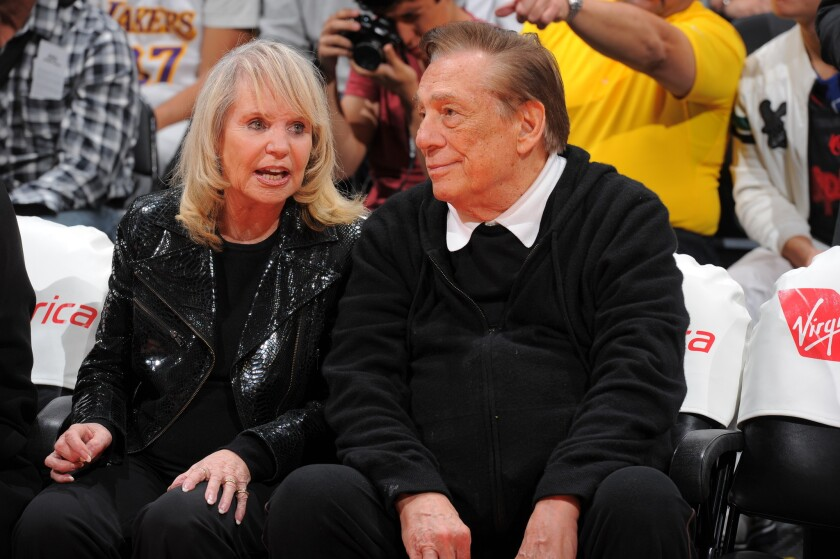Shelly and Donald Sterling watch the Clippers play a game against the Indiana Pacers last season at Staples Center.