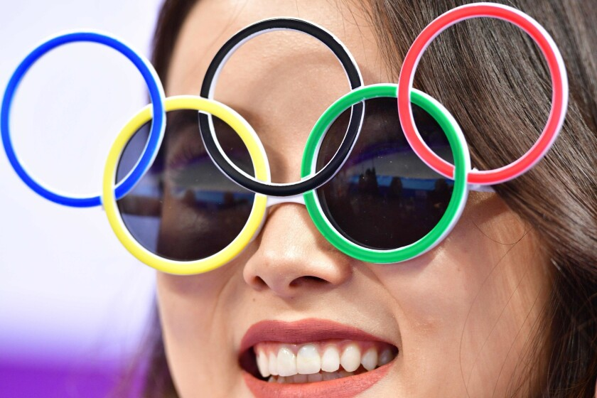 A woman wears Olympic rings sunglasses during the figure skating team event men's single skating short program during the Pyeongchang 2018 Winter Olympic Games at the Gangneung Ice Arena in Gangneung on February 9, 2018.
