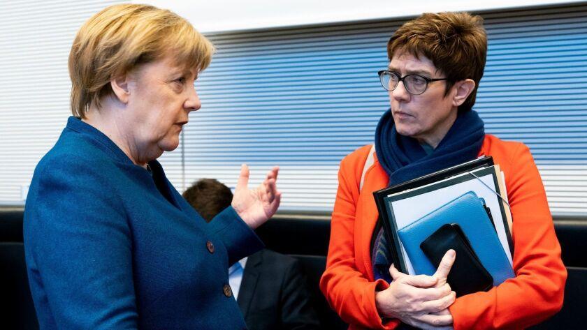 German Chancellor Angela Merkel, left, and Christian Democratic Union leader Annegret Kramp-Karrenbauer talk Feb. 12, 2019, before a meeting in Berlin.