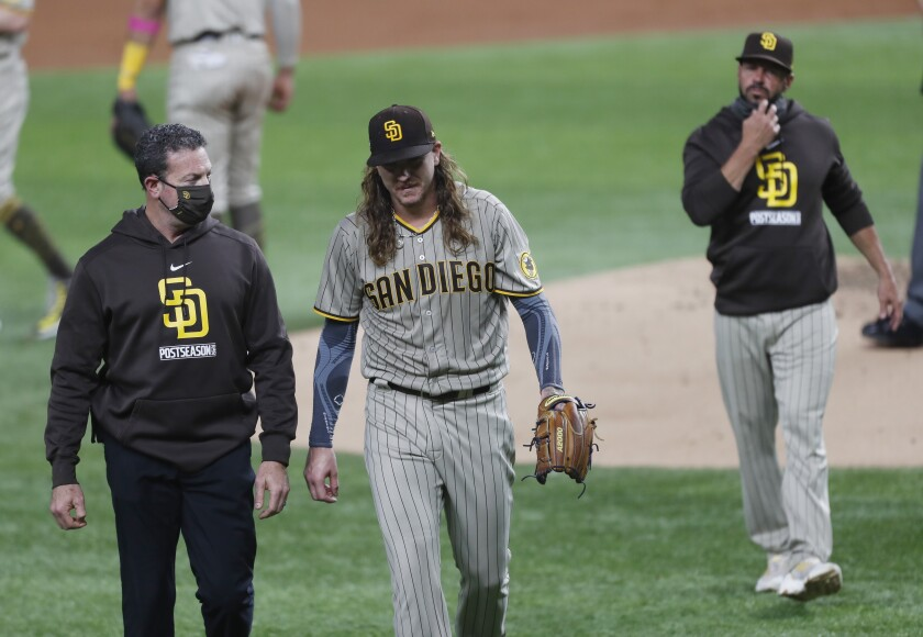 Mike Clevinger of the San Diego Padres is pulled from the game by manager Jayce Tingler (right) in the second inning Tuesday.