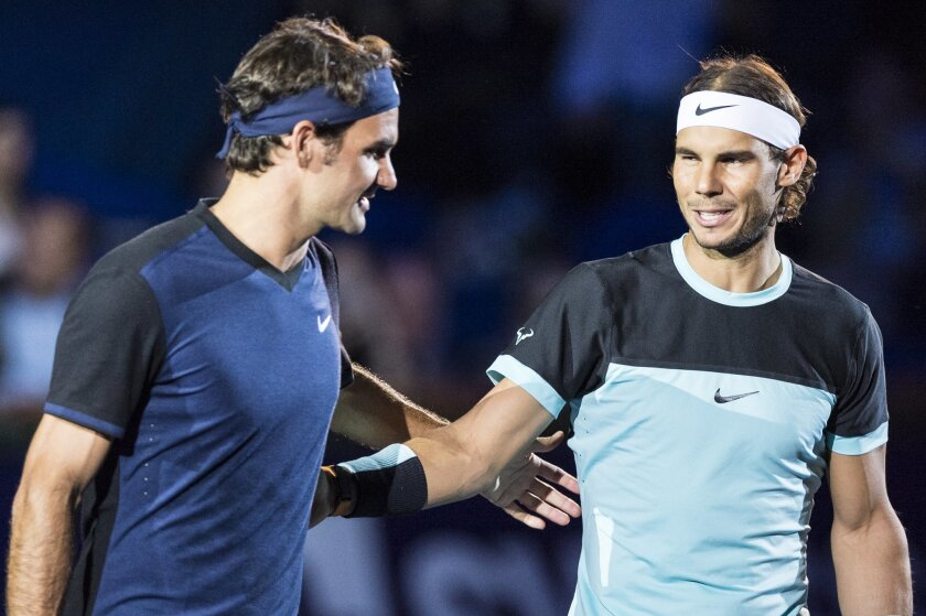 Switzerland's Roger Federer, left, and Spain's Rafael Nadal, right, share a word before their final match at the Swiss Indoors tennis tournament at the St. Jakobshalle in Basel, Switzerland, Sunday, Nov. 1, 2015. (Dominic Steinmann/Keystone via AP)