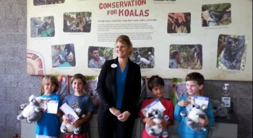 Del Mar Heights students, from left, Cade, Quinn, Taj and Jacob with a San Diego Zoo staff member. Courtesy photo