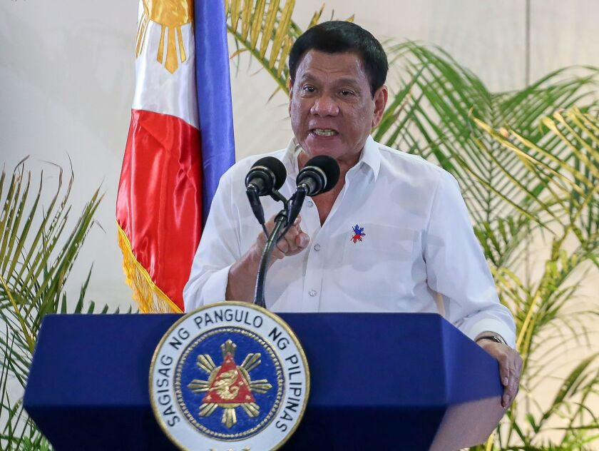 Philippine President Rodrigo Duterte speaks at a news conference a day after he boasted that he had killed criminals.