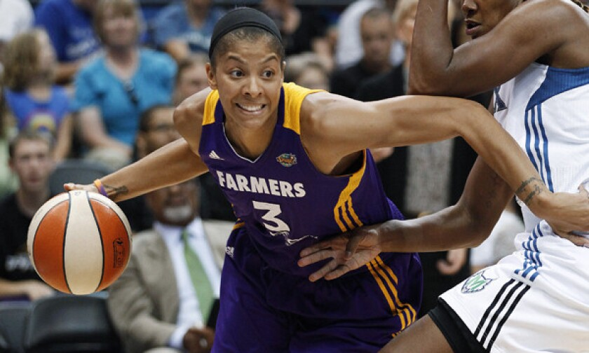 Sparks star Candace Parker drives past Minnesota's Rebekkah Brunson during a game in 2012. The WNBA has taken over control of the Sparks franchise.