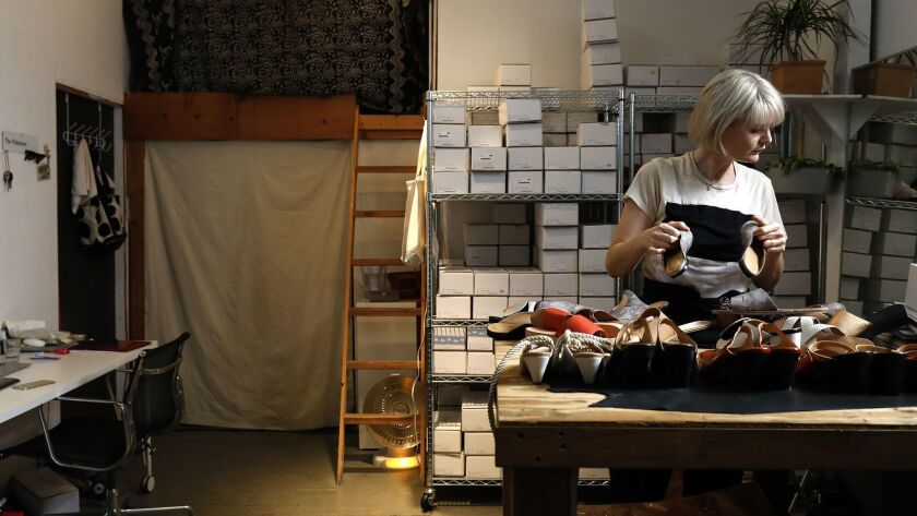 LOS ANGELES-CA-JUNE 5, 2018: Jessica Taft Langdon sorts through shoes at her studio for her women's