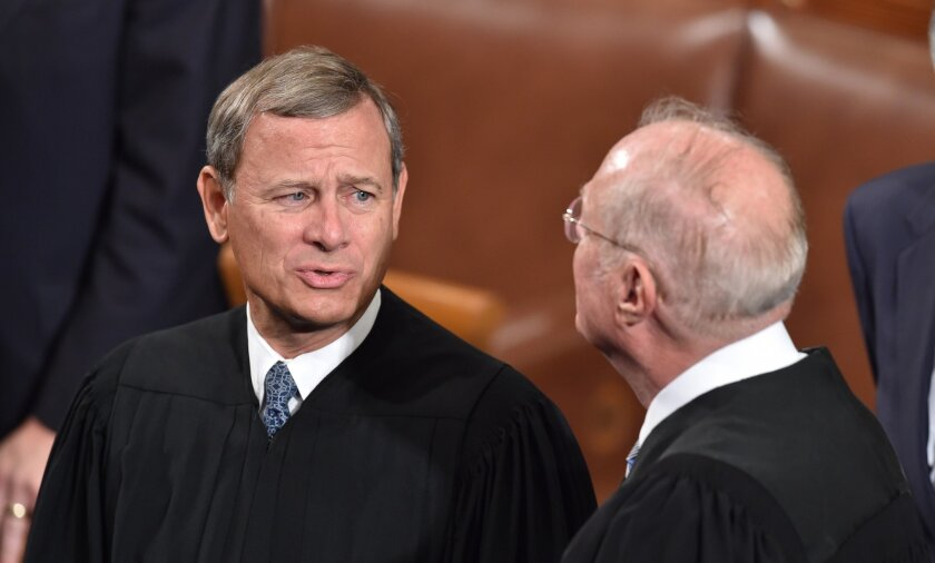 Chief Justice John Roberts and other members of the U.S. Supreme Court arrives before Pope Francis addresses the joint session of Congress on Sept. 24 in Washington, DC.