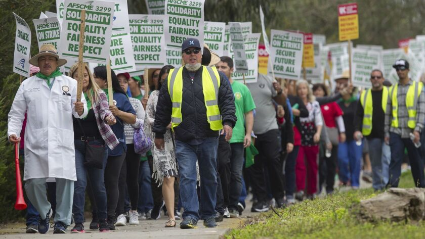 AFSCME workers, who were joined by nurses and technical workers, picket at UCSD Jacobs Medical Center on May 8.