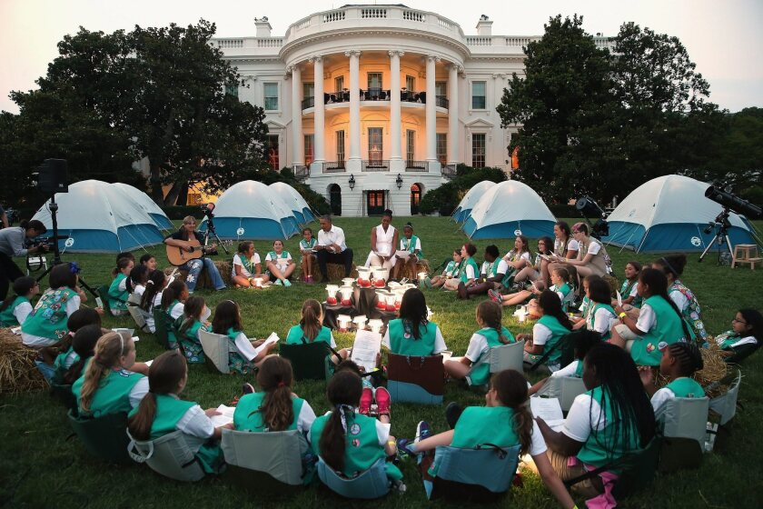 President Obama and First Lady Michelle Obama host a group of Girl Scouts from across the U.S. for a camp-out on the South Lawn of the White House.