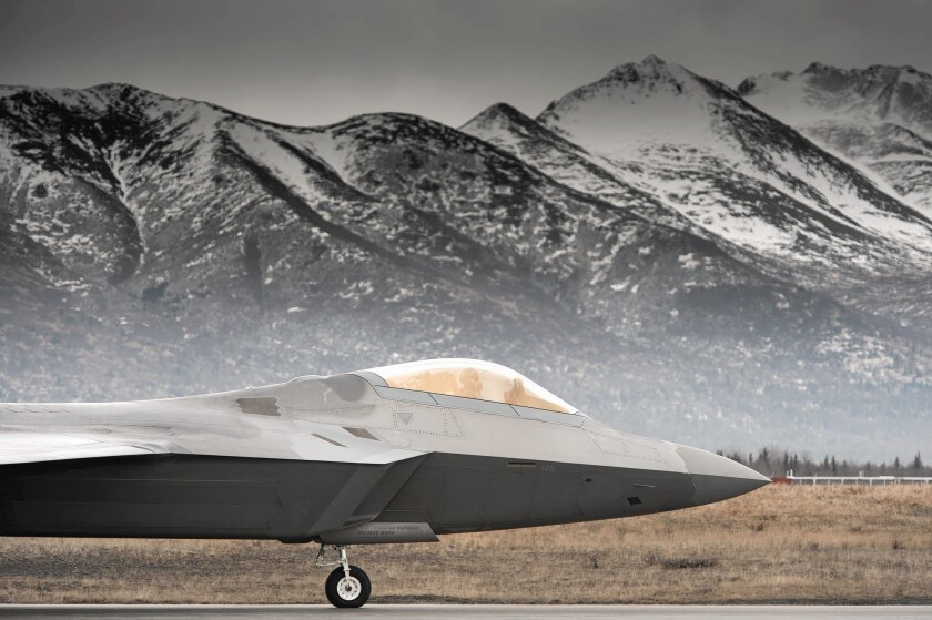 With Alaska's Chugach Mountains as a backdrop, an F-22 taxis on the runway. F-22s are used to monitor Russian aircraft.