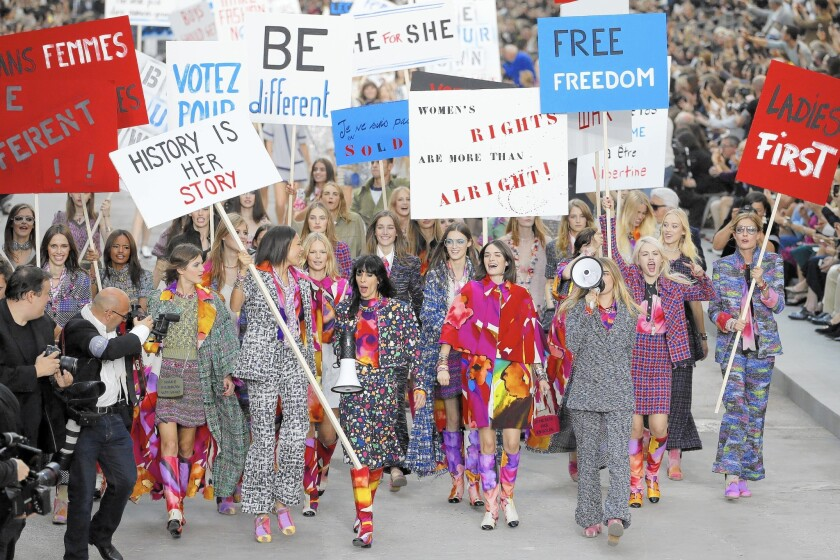 Cara Delevingne and other models 'protest' during Chanel show