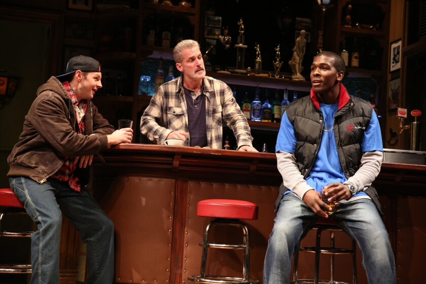 """The factory worker characters in """"Sweat"""" at the Public Theater in New York."""