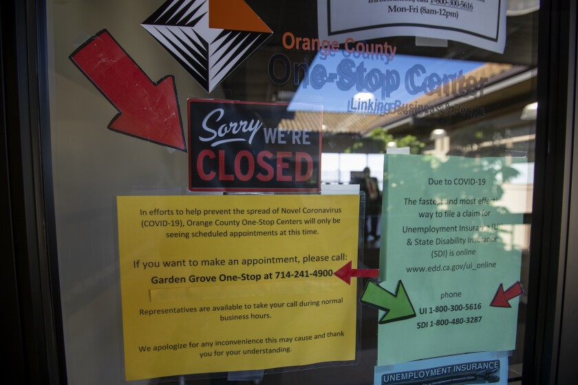 Signs are posted in May on the doors of the Orange County One-Stop Center in Garden Grove.