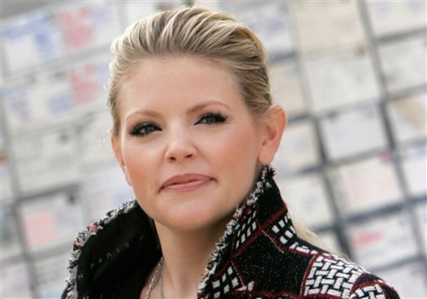 In this Dec. 19, 2007 file photo Dixie Chicks lead singer Natalie Maines attends a rally in support of three Arkansas prison inmates in Little Rock, Ark. Maines is the target of a defamation lawsuit by the stepfather of one of three 8-year-old boys slain in West Memphis. Maines spoke out for three people convicted of the slayings and alleged the stepfather was instead involved in the killings. (AP Photo/Danny Johnston, File)