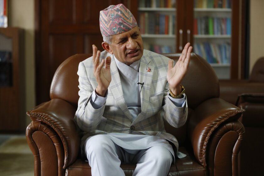 Nepal's foreign minister Pradeep Gyawali gestures during an interview with the Associated Press in Kathmandu, Nepal, Tuesday, June 9, 2020. Gyawali said Tuesday that the country was still waiting for a response from India on holding talks to resolve a border dispute that has strained relations between the South Asian neighbors. (AP Photo/Niranjan Shrestha)