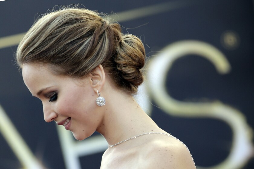 """Lead actress nominee Jennifer Lawrence (""""Silver Linings Playbook"""") on the red carpet."""